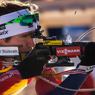 Emil Hegle Svendsen reloading the rifle on the world cup in biathlon on Pokljuka